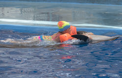Little girl swim on dolphin Royalty Free Stock Photography