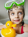 Little girl with swim glasses and a toy Stock Photography