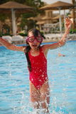 Little Girl in Swim Goggles Splashing Royalty Free Stock Image