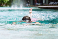 Little girl swim in the pool Royalty Free Stock Photography
