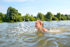 Little girl swim on river Royalty Free Stock Photography