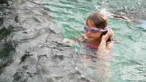 Little girl swim underwater in swimming pool. Slow Motion. Little girl swim underwater in pure indoor swimming pool. Diving in Swimming Pool -Slow Motion stock video