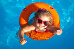Little girl swimming Stock Photos