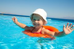 Little girl swimming Stock Image