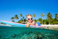 Little girl swimming Stock Images