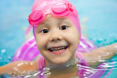 Little girl swimming Royalty Free Stock Photo