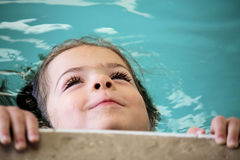 Little girl swimming Royalty Free Stock Photography