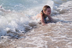 Little girl is swimming Stock Image