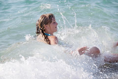 Little girl is swimming Stock Photos