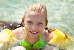 Little girl swimming Royalty Free Stock Image