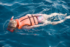 Little girl swimming in diving mask Stock Image