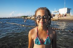 Little girl with swimming glasses stock photos
