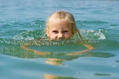 Little Girl Swimming In Lake Stock Photo
