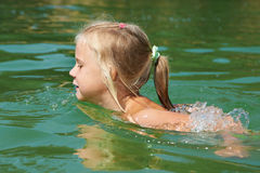 Little Girl Swimming In Lake Royalty Free Stock Photos