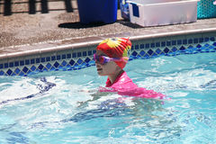 Free Little Girl Swimming In Pool Stock Image - 95276321