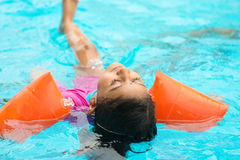 Little girl swimming Royalty Free Stock Images