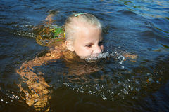 Little girl swimming in lake Royalty Free Stock Photography