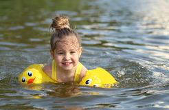 Little girl swimming in lake outdoors. Closeup Royalty Free Stock Images