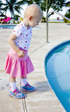 Little girl at swimming pool stock photography
