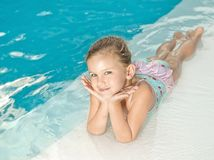 Girl in the swimming pool. Little girl in the swimming pool Stock Images