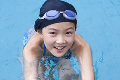Little girl in swimming pool. 9-year old little asian girl in swimming pool Stock Image