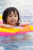 Little girl in swimming pool. Little girl is having fun in swimming pool Royalty Free Stock Photos