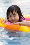 Little girl in swimming pool. Little girl is having fun in swimming pool Stock Image