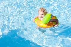 Little girl in swimming pool Stock Images