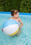Little girl swimming in pool Stock Image