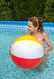 Little girl swimming in pool Stock Image