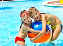 Children swimming in pool. Little girl swimming in pool royalty free stock photo