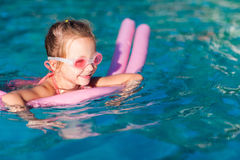 Little girl at swimming pool Stock Photos