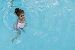 Little girl swimming in  pool Stock Photography