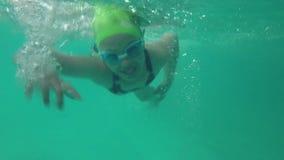 Little girl swimming in pool stock video