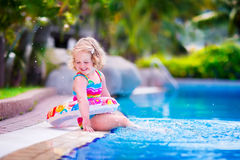 Little girl in a swimming pool Royalty Free Stock Photos