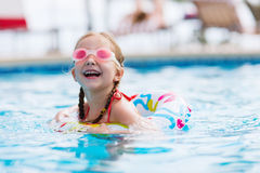Little girl in swimming pool Royalty Free Stock Images