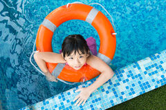 Little girl in swimming pool Stock Photos