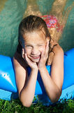 Little girl in swimming pool Stock Image