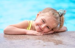 Little girl in a swimming pool Stock Image