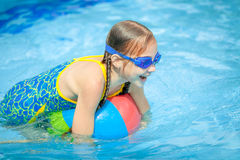 Little girl in the swimming pool Stock Photography