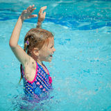 Little girl in the swimming pool Stock Photo
