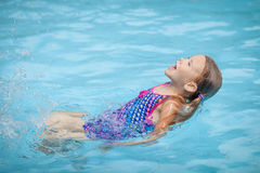 Little girl in the swimming pool Stock Images
