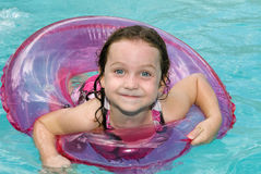 Little girl in swimming pool with float ring. Royalty Free Stock Photos