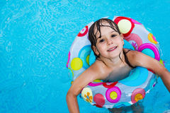 Little girl in swimming pool with float ring Royalty Free Stock Images