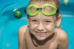 Little girl in swimming pool with goggles Royalty Free Stock Images