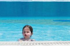 Little girl swimming in a pool. Happy little girl swimming in a pool Royalty Free Stock Image