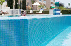 Little girl swimming in a pool Stock Photography