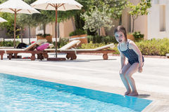 Little girl swimming in a pool Royalty Free Stock Images