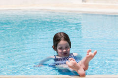 Little girl swimming in a pool Royalty Free Stock Image