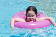 Little girl swimming in a pool Royalty Free Stock Photos